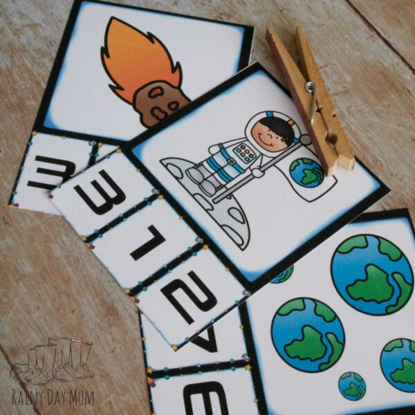 free printable space themed count and clip cards with cartoon images for preschoolers to count and find the matching numbers