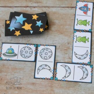 space themed picture domino game set out on a table ready to play with your preschoolers