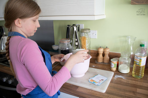 tween using the visual recipe card for easy bread dough to make some bread in homeschool